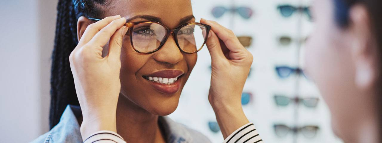 Woman trying a new pair of eyeglasses in Lake Mary & Orlando, FL
